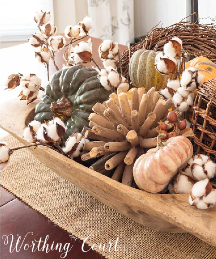 wood bowl filled with a variety of fall items
