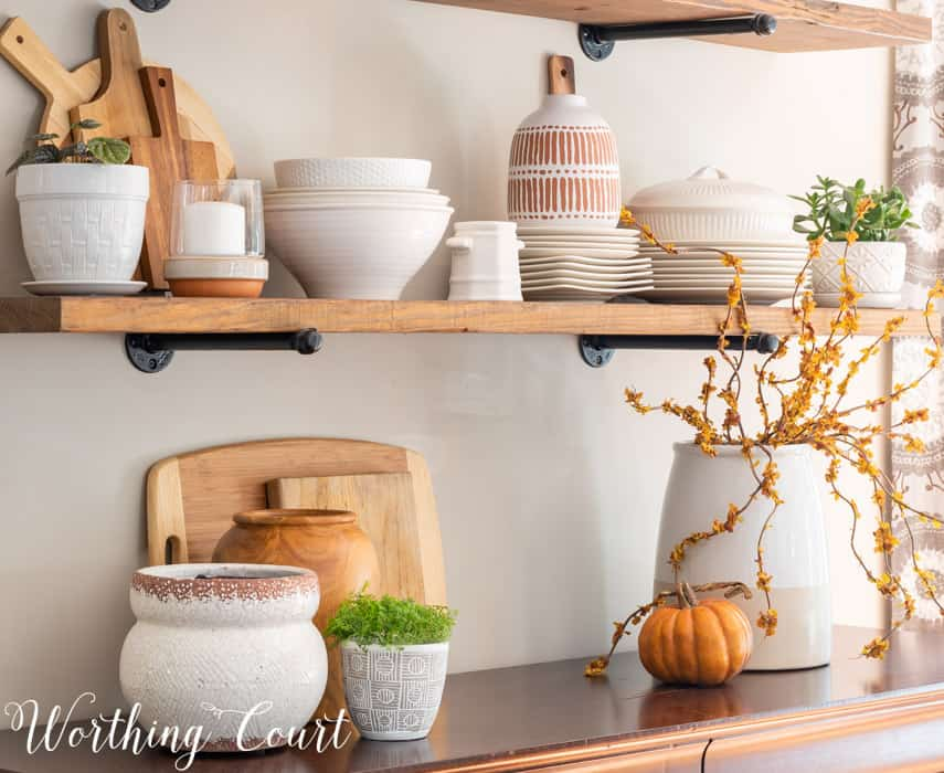 open shelves decorated for all with white dishes