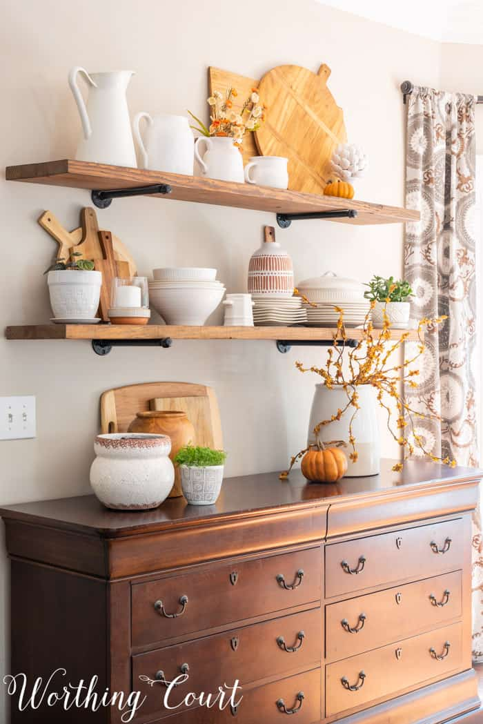 Dining area with opens shelves and fall decor