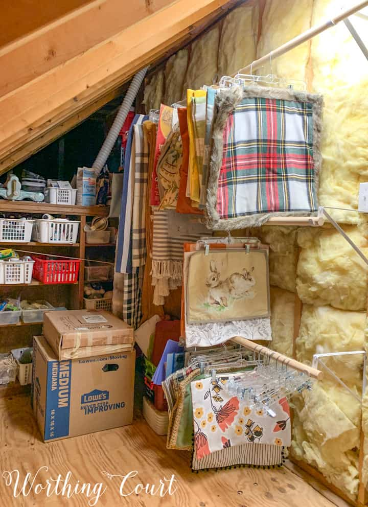 pillow covers and blankets hanging in an attic
