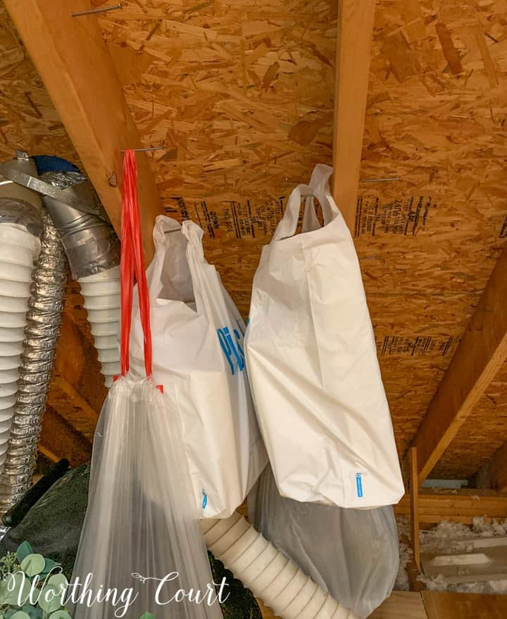 storage bags hanging from ceiling rafters