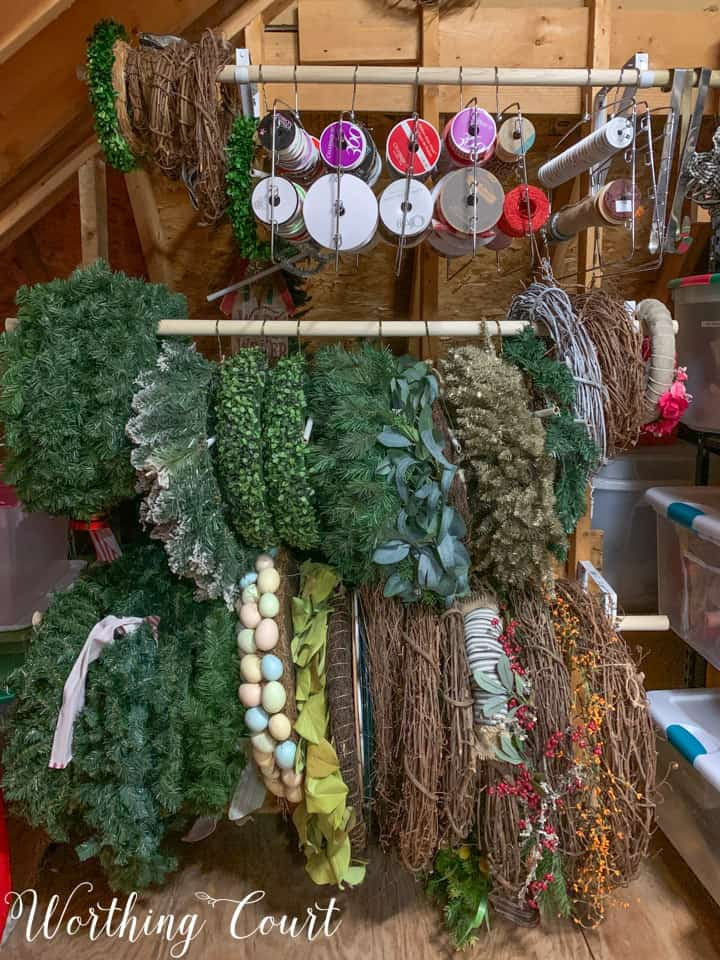 wreaths stored on dowel rods in attic