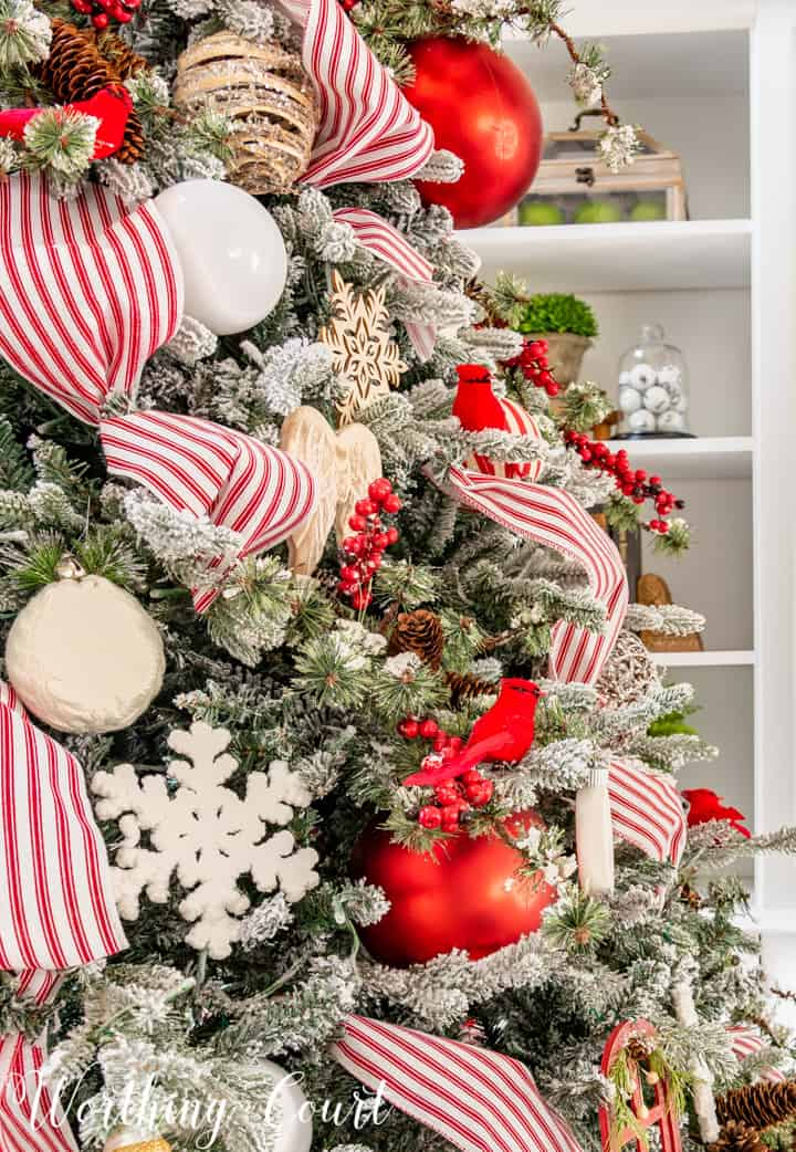 partial view of Christmas tree with red and white decorations