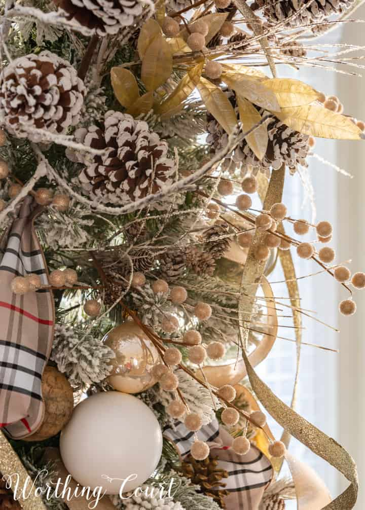 Flocked Christmas tree decorated with gold and neutral colors