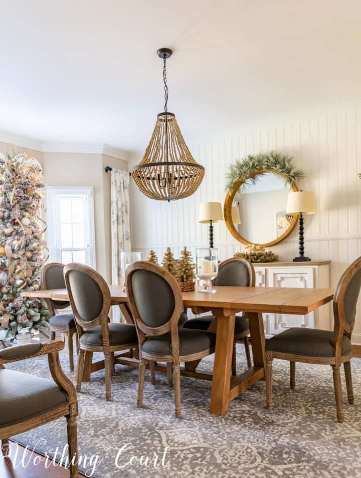 dining room table, chairs and sideboard decorated with neutral colors for Christmas