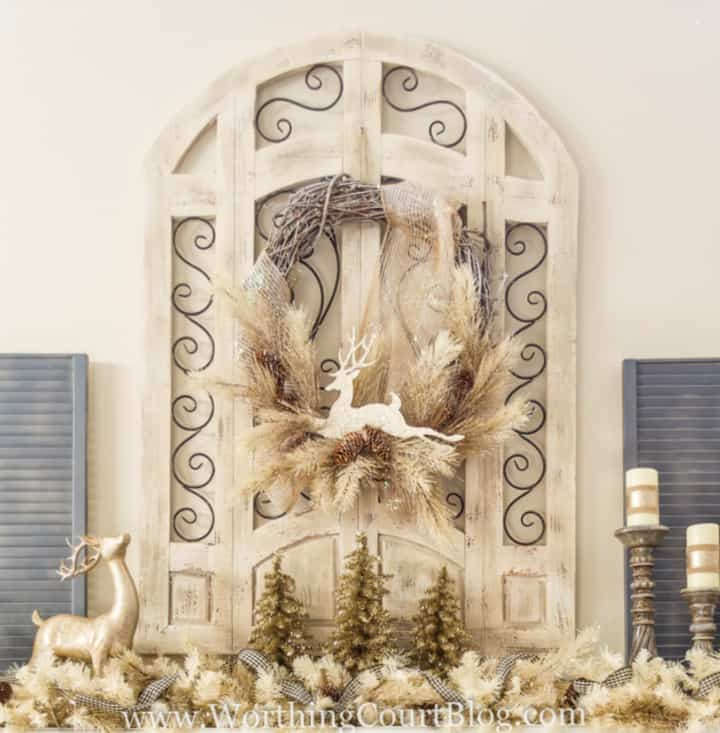 Christmas wreath with frosted neutral pine stems and a glittery deer