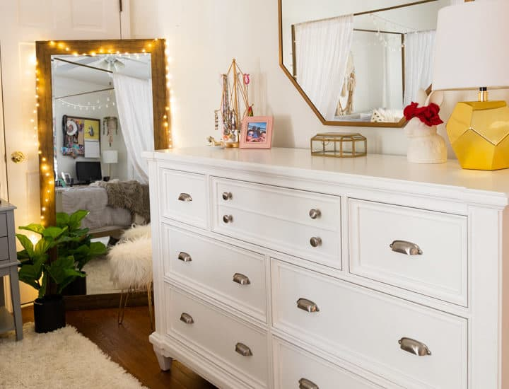 white dresser with octagonal mirror above