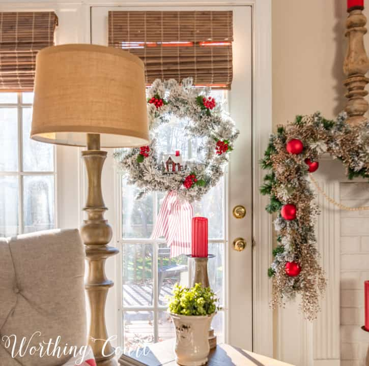 French door with flocked wreath hanging on it