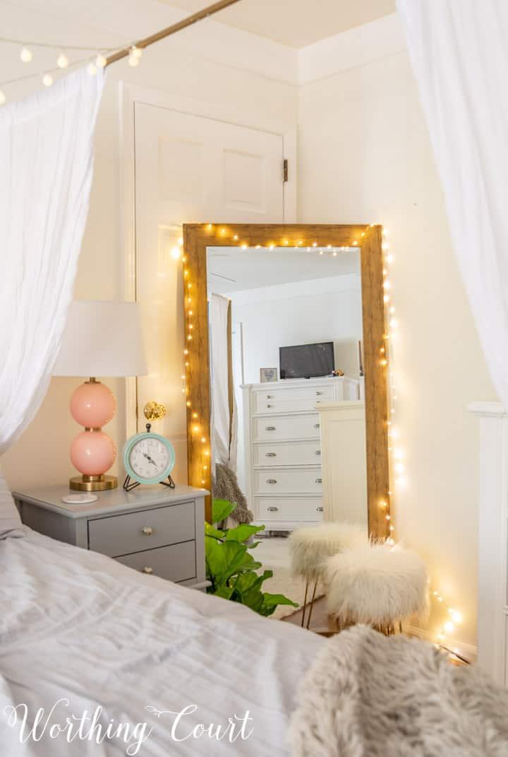 full length mirror draped with fairy lights