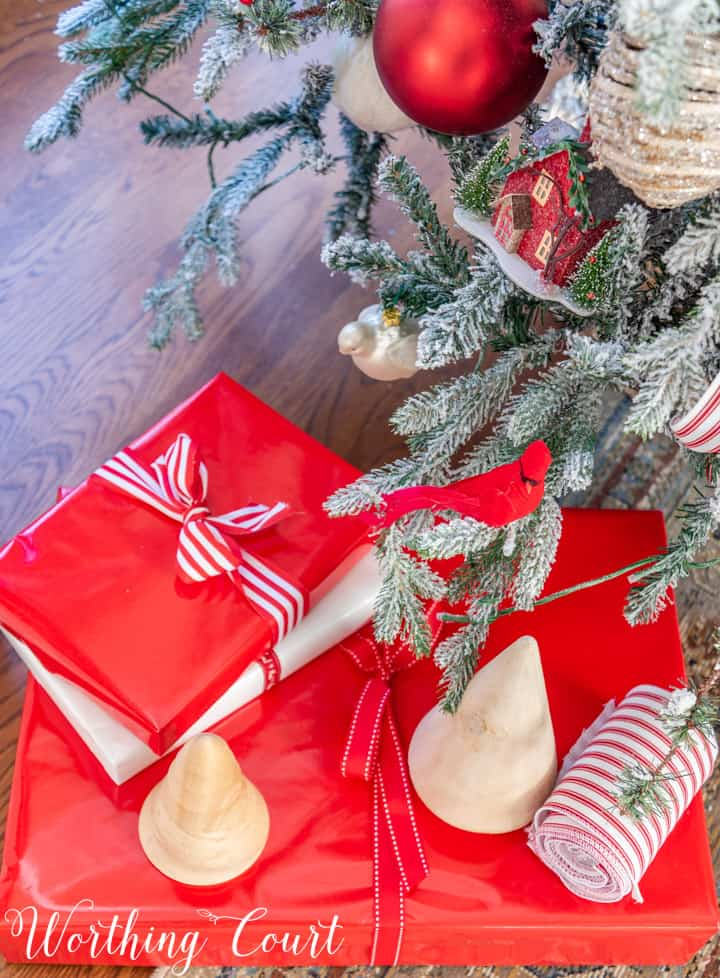 Christmas presents in red wrapping paper with red and white ribbon