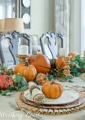 Thanksgiving centerpiece with pumpkins and greenery