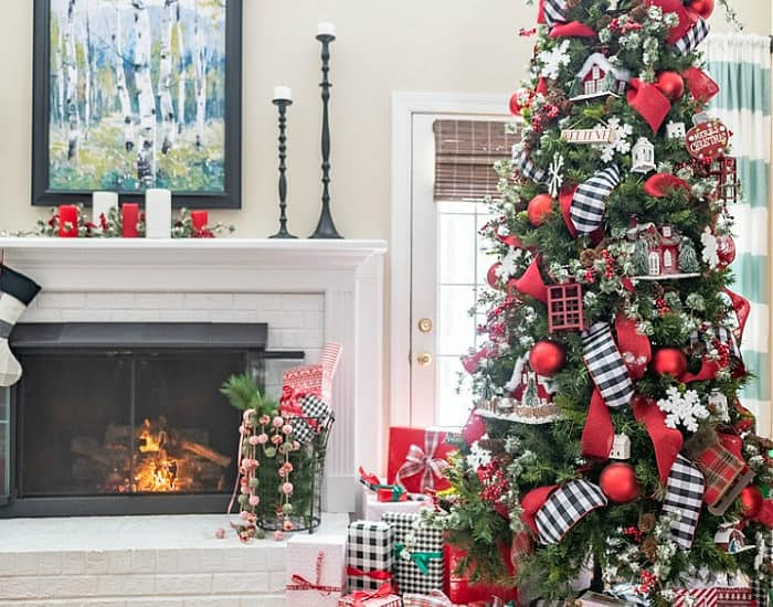 decorated Christmas tree and presents beside fireplace