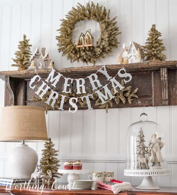 Christmas display with neutral colors on shelf and on sideboard
