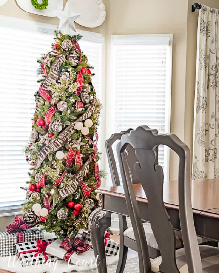 Christmas tree decorated with red, black and white ornaments