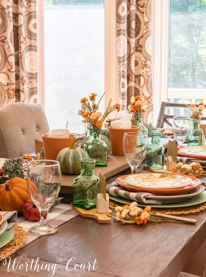 Thanksgiving table set with traditional fall colors and elements