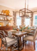 dining room with open shelves and table set for Thanksgiving