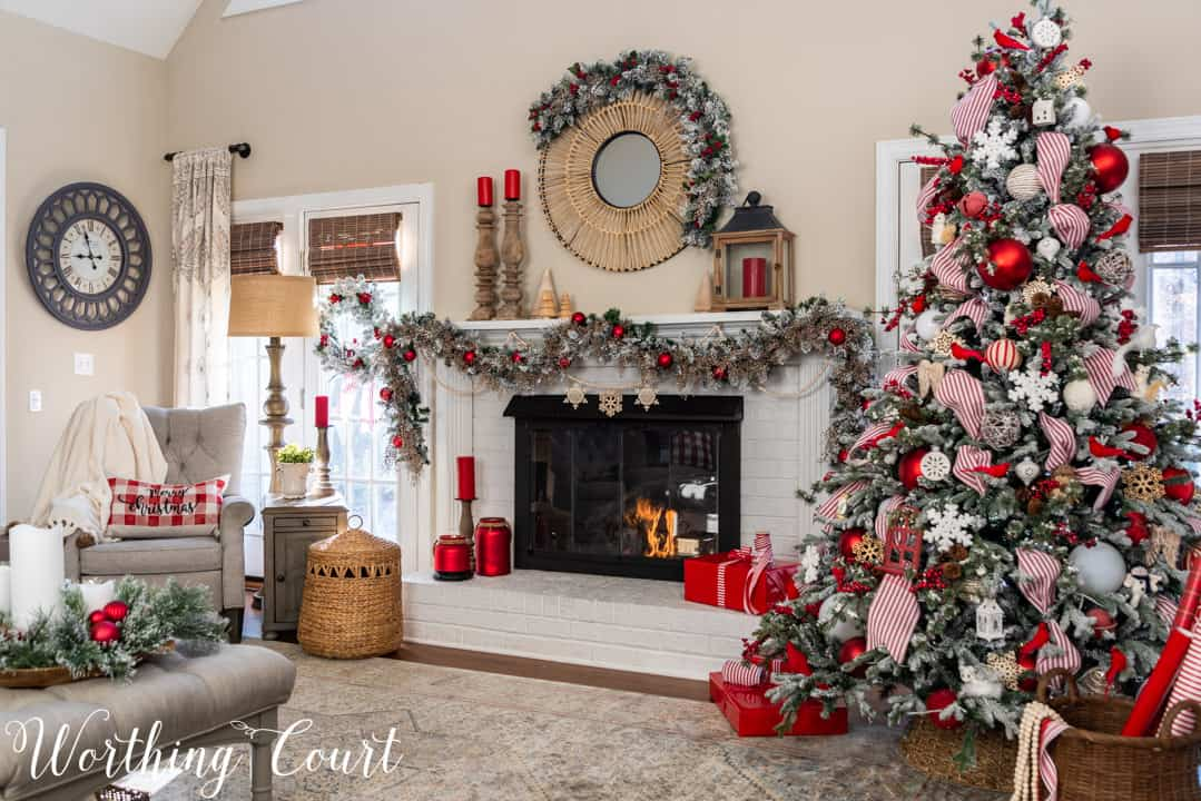 white fireplace with red and white Christmas decor