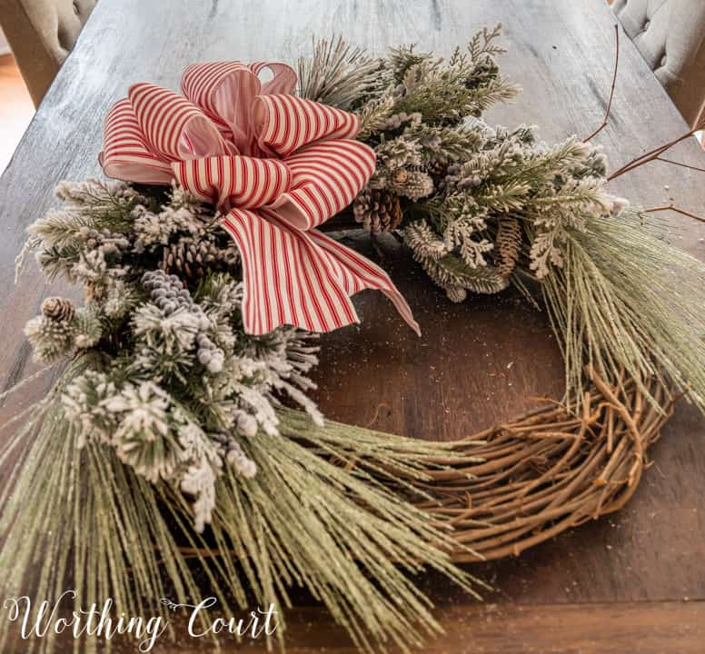partially assembled Christmas wreath lying on a table