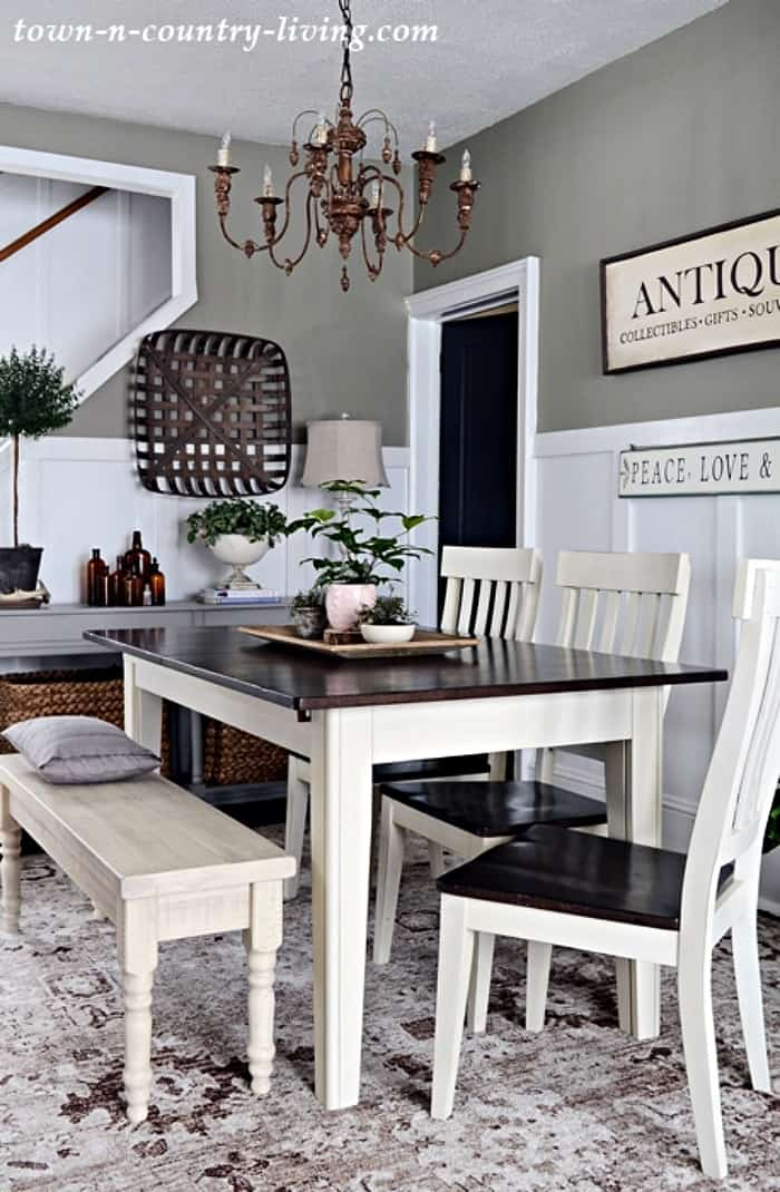 dining room table with wood top, white legs with white chairs and bench
