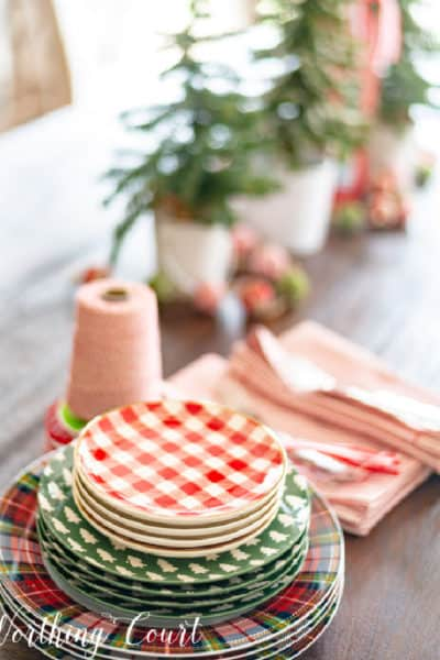 table with stack of various Christmas dishes on one end