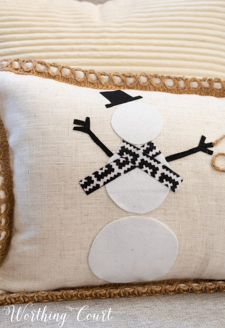 closeup of felt snowman on a pillow