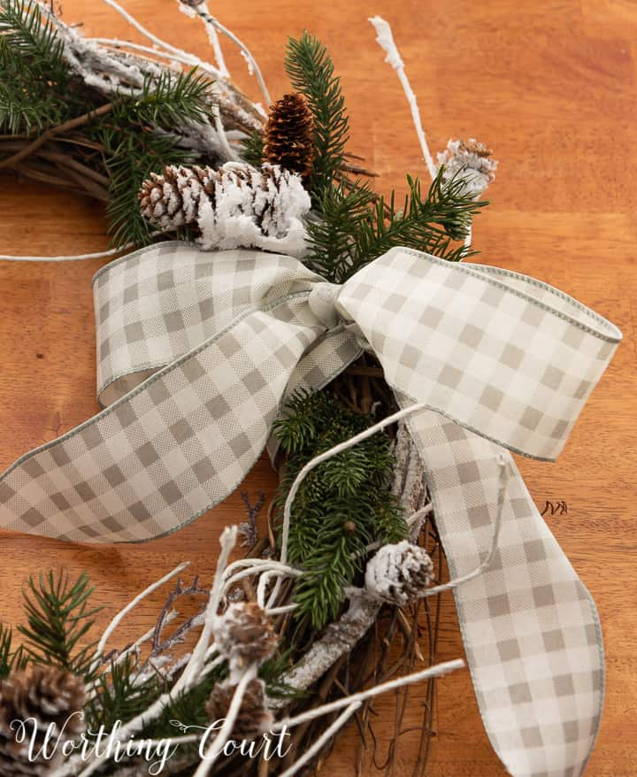 closeup of a gray and white checked bow on a wreath