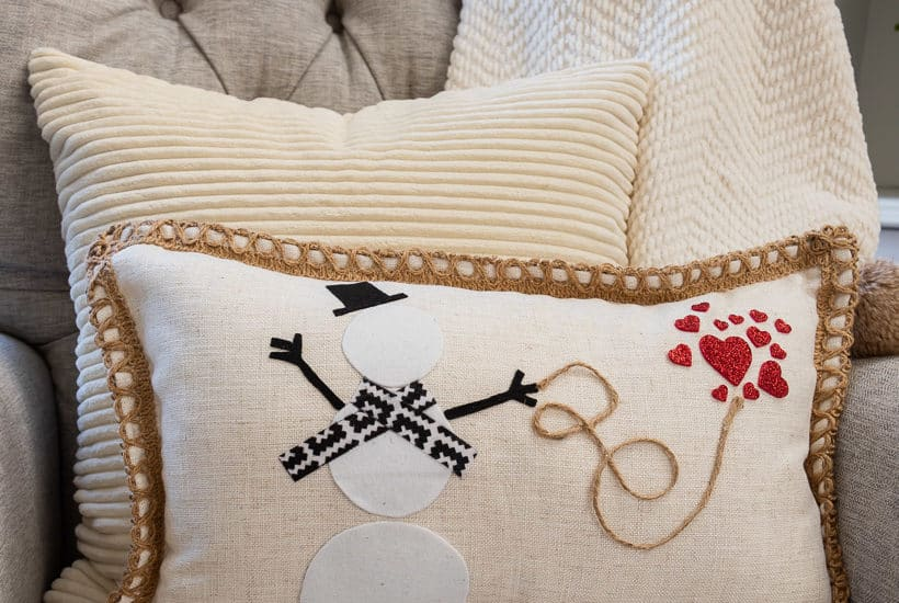 pillow with snowman and red hearts in a gray chair