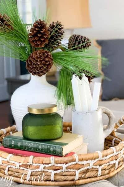 winter vignette in a round basket on a coffee table