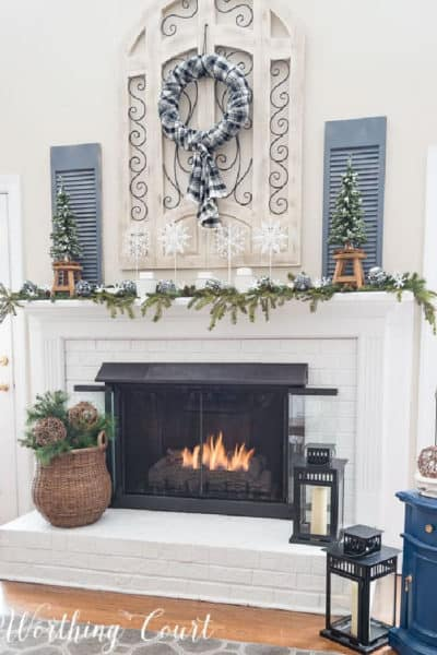 white brick fireplace with winter decorations
