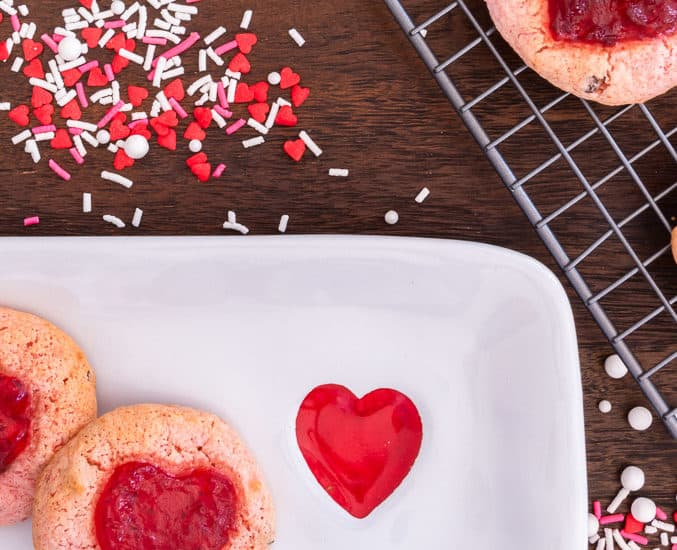 strawberry cookies on a cooling rack