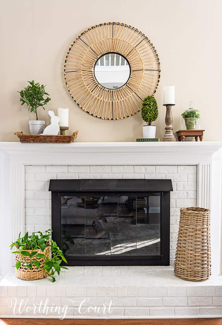 white fireplace with spring decorations on the mantle