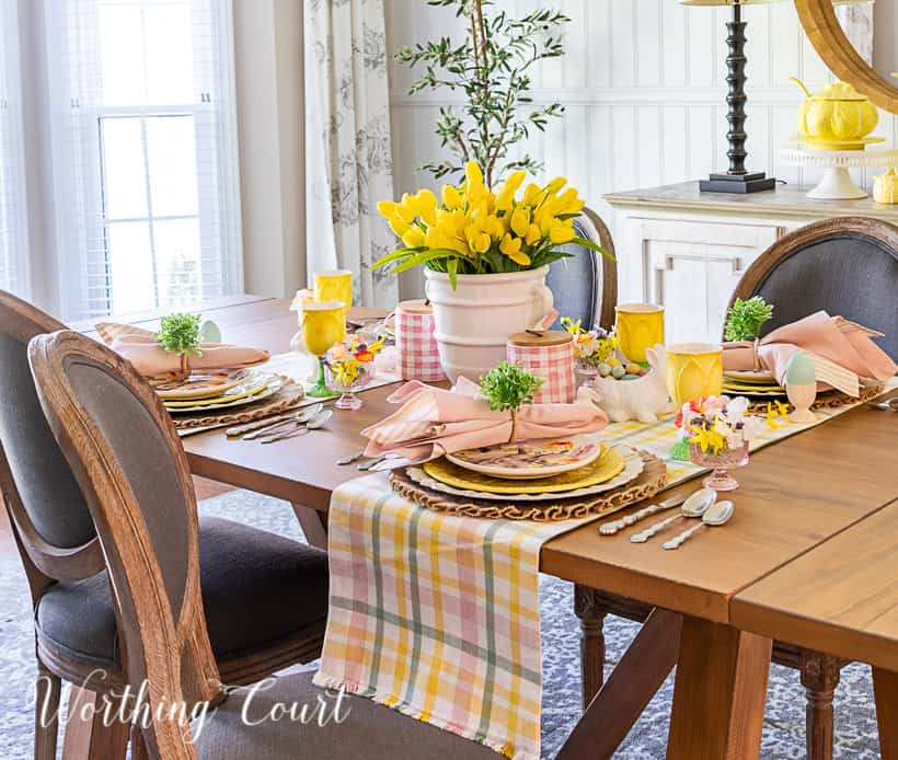 Easter tablescape using yellow dishes and faux flowers