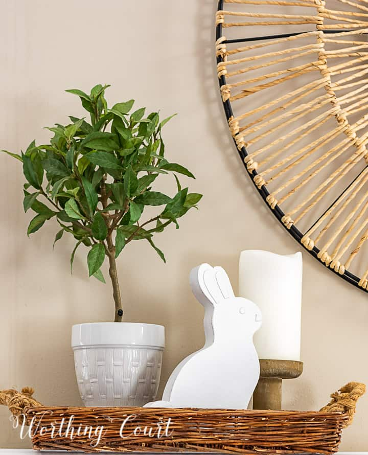 spring vignette in a tray with a topiary, candle and white bunny