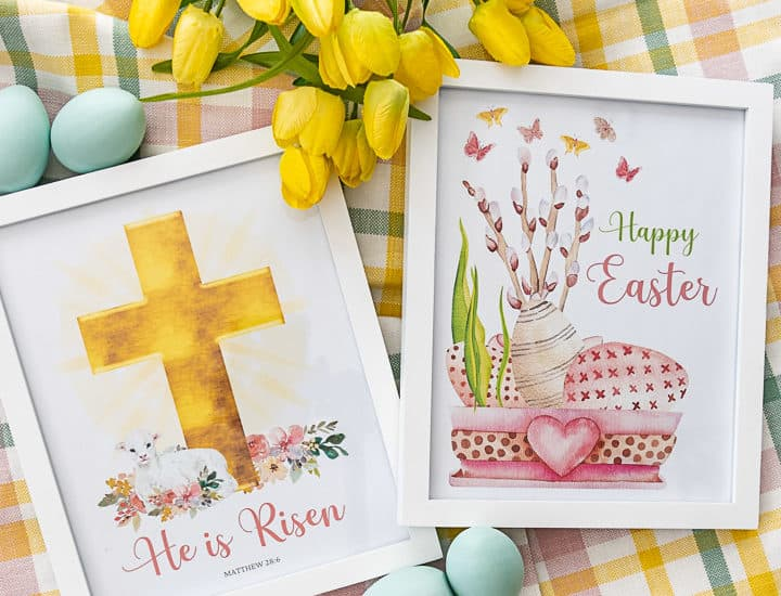 pair of framed Easter printables lying on a plaid piece of fabric