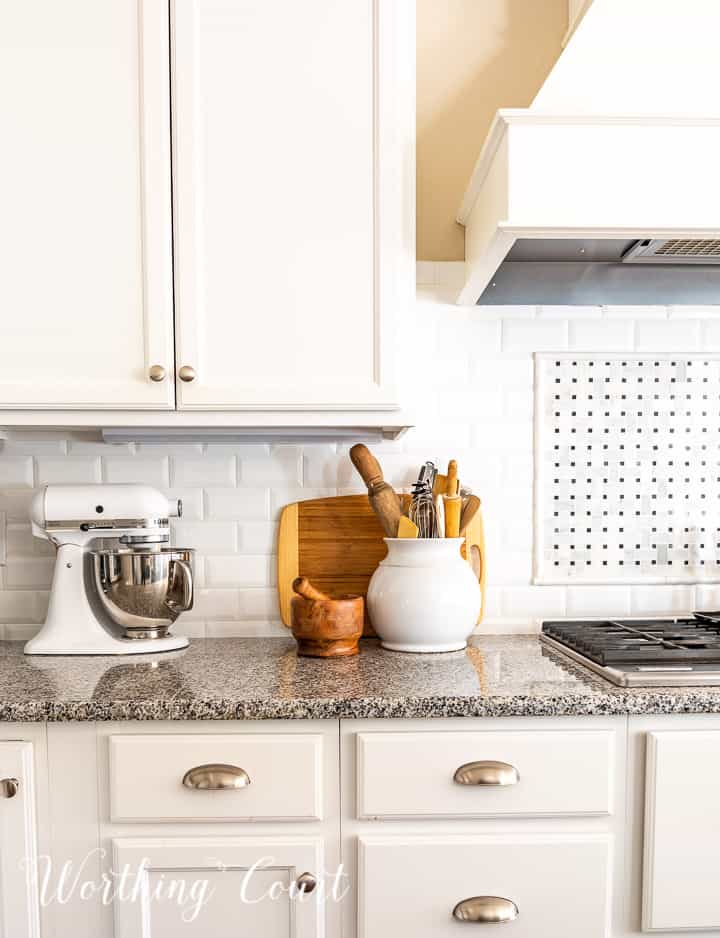 kitchen counter decorations against a white subway tile backsplash