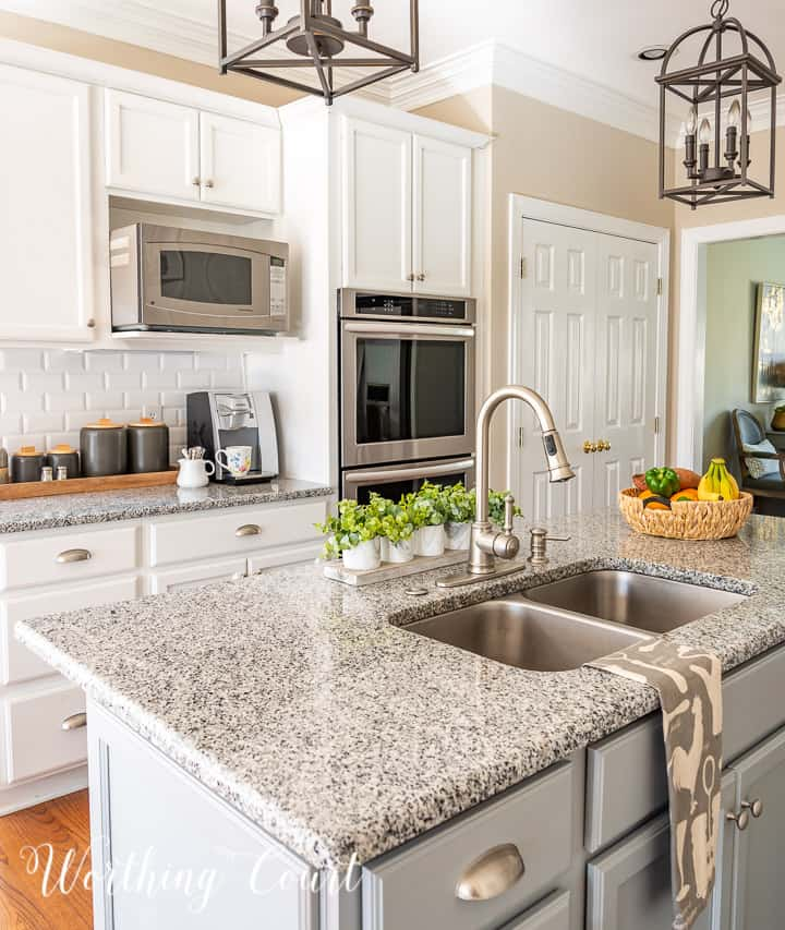view of kitchen with white cabinets and gray island