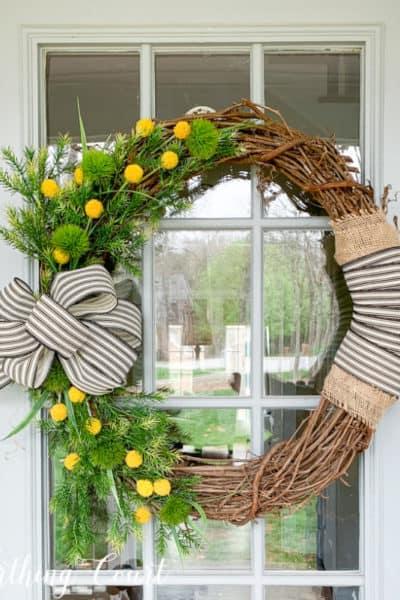 spring wreath hanging on glass front door