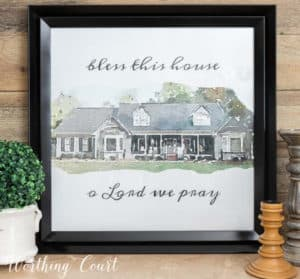 watercolor image on gray house in a black frame