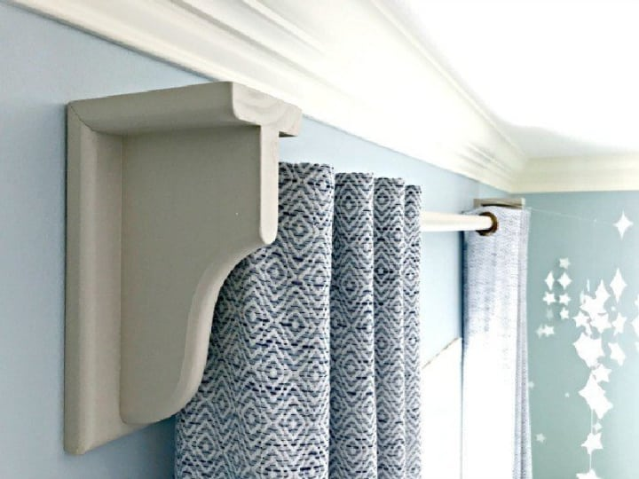draperies hanging from wood curtain rod