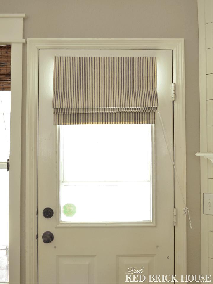 roman shade on a door with window