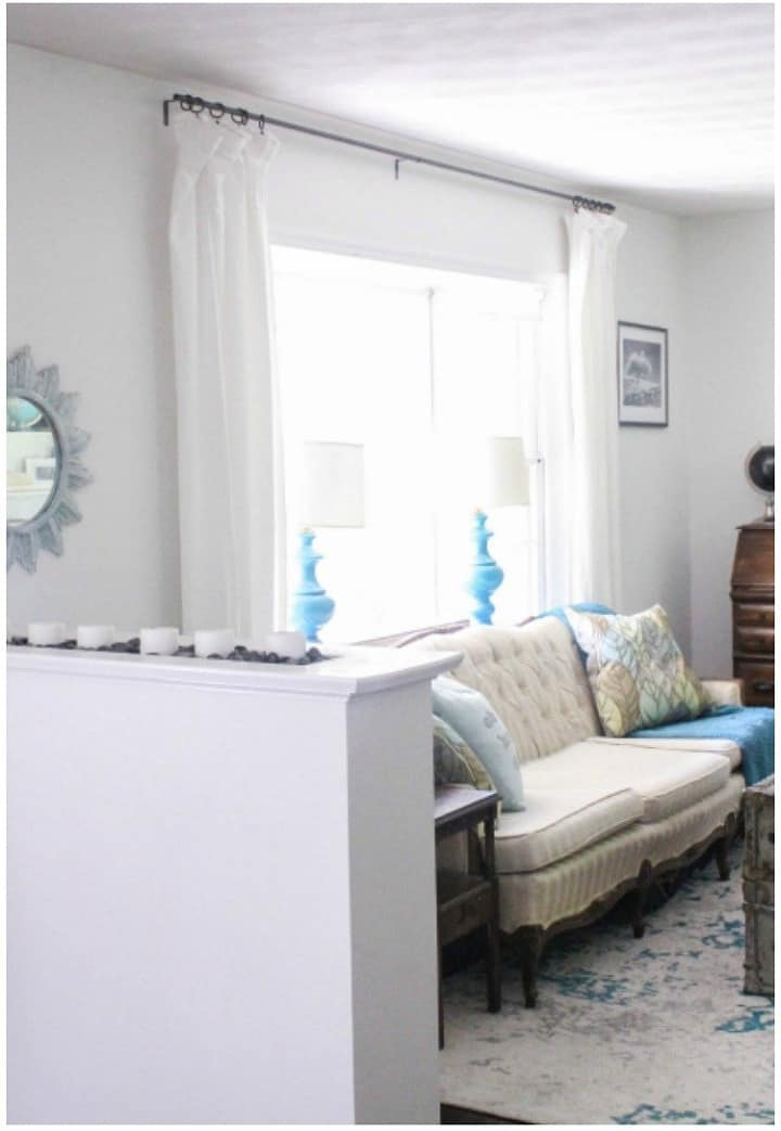 white curtains on window behind sofa