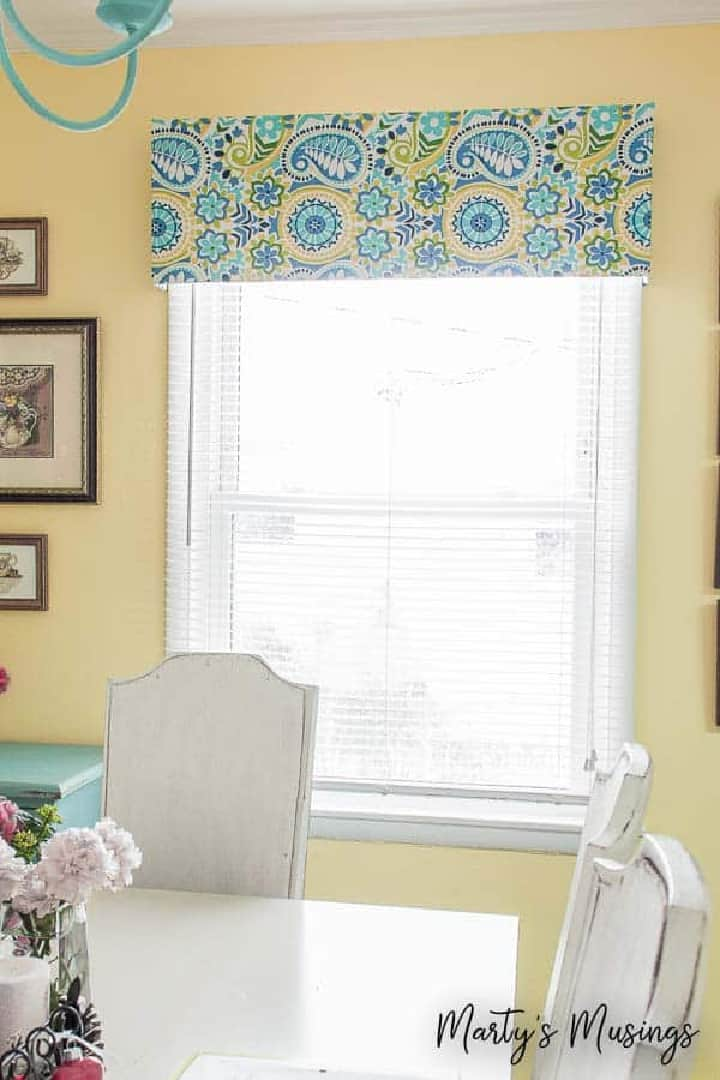 window valance with blue and yellow fabric