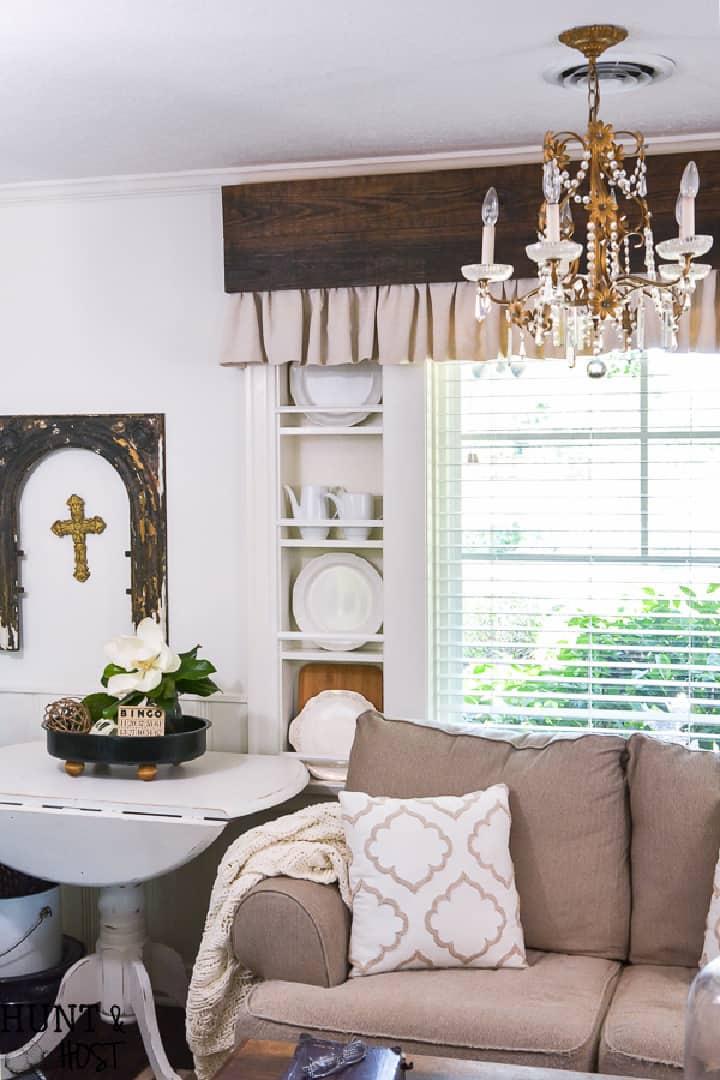 wood cornice with fabric valance above sofa