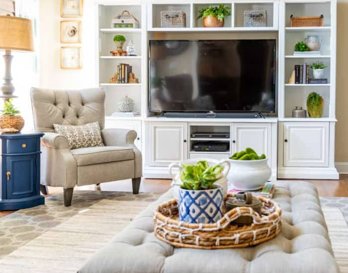 white entertainment center, chair and coffee table in a family room