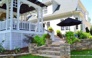 white deck with flagstone stairway