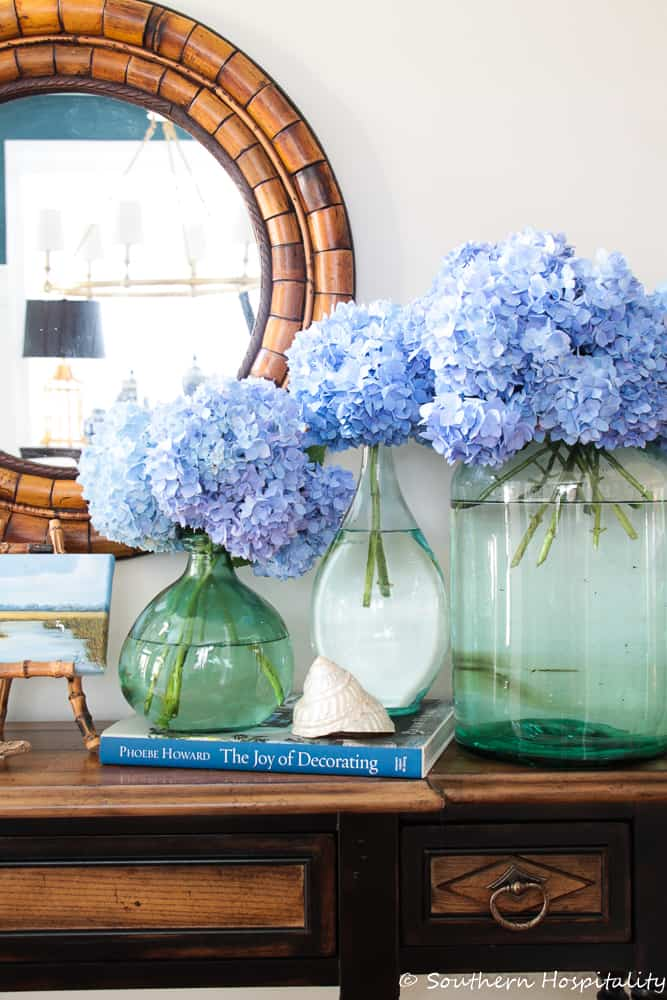 vases filled with blue hydrangea stems