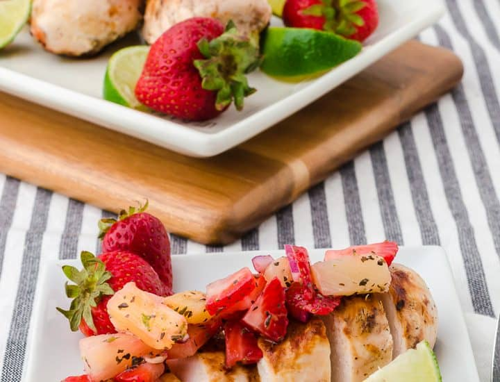 sliced grilled chicken breast topped with strawberry and pineapple salsa
