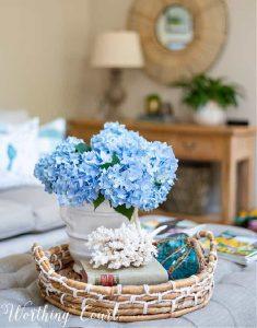blue hydrangeas in a coffee table vignette
