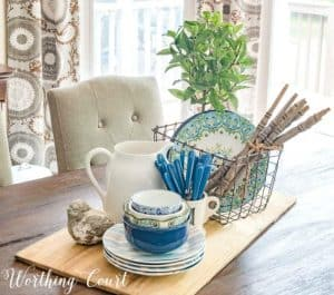 centerpiece with blue and white dishes