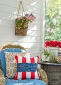 chair with blue cushions surrounded by patriotic decor